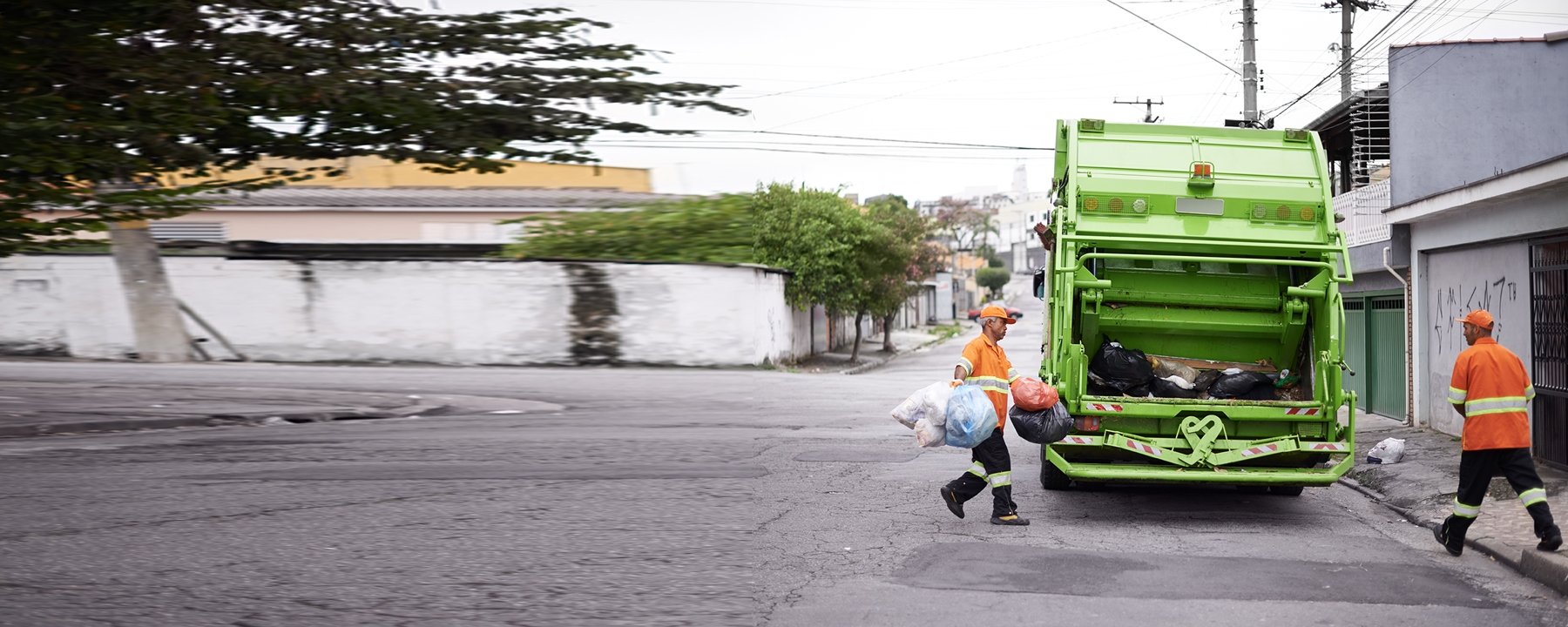 Truck and crew collecting waste and recycling