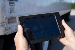 omnitracs mobile device being held with two hands