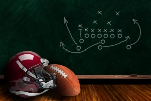 football helmet and chalkboard